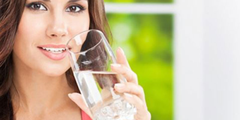 Woman drinking clean fresh water